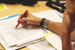 Woman Filling Out Commercialization Plan