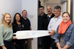 people posing with milled prototype